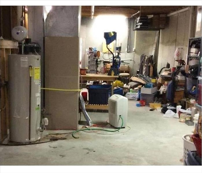 Basement with a dry floor and SERVPRO dehumidifier