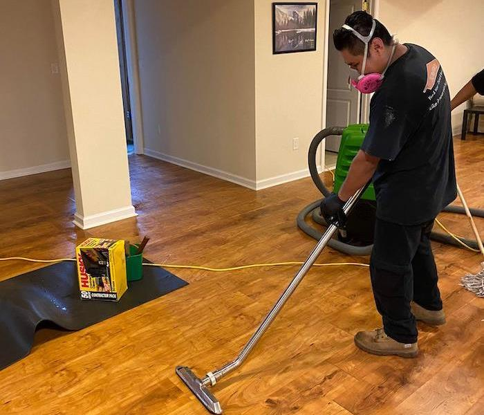 SERVPRO technician with water removal equipment