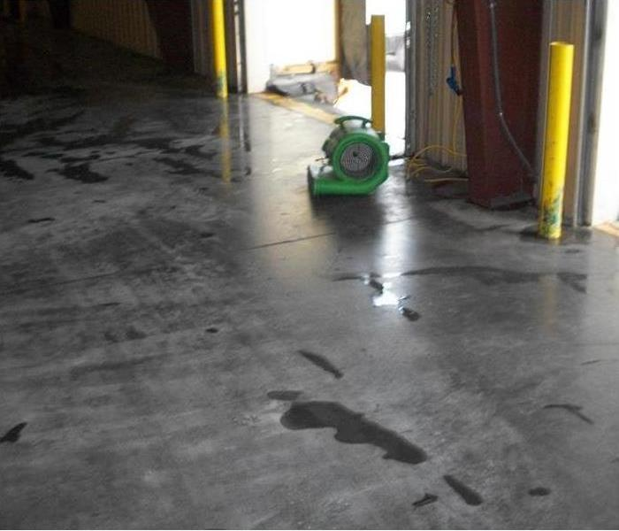 air mover on concrete floor by bay door opening