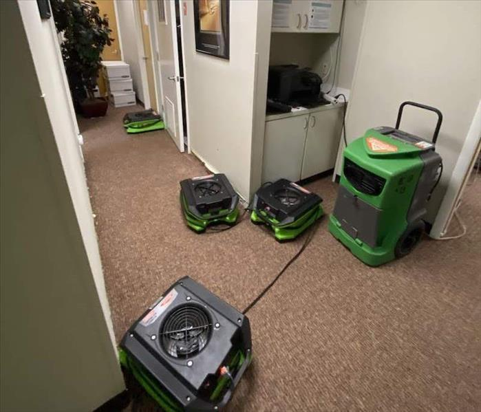 SERVPRO equipment at work drying water damage