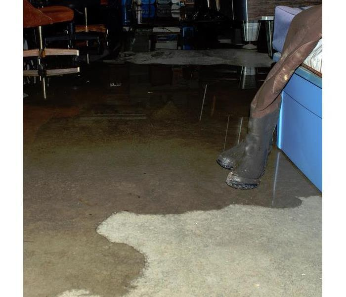 flooded basement with water boots near it