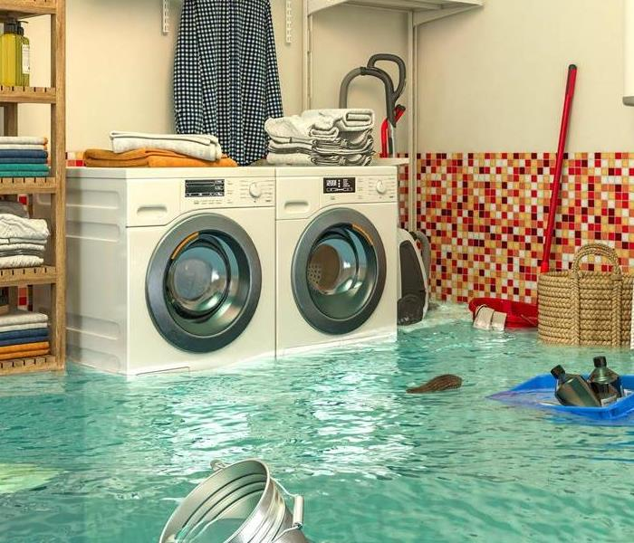 A flooded room with appliances partially under water